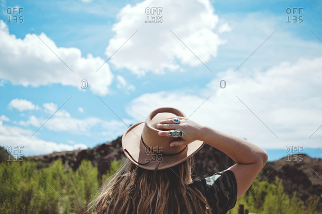Woman in hat staring the nature