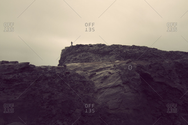Person standing on a cliff in rural Iceland