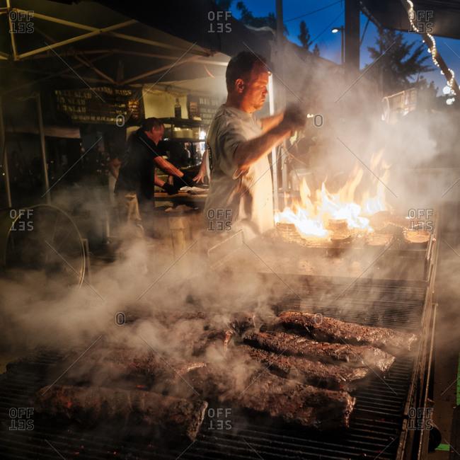 September 1, 2012 - Sparks, Nevada: Barbecue rib master cooking racks of pork