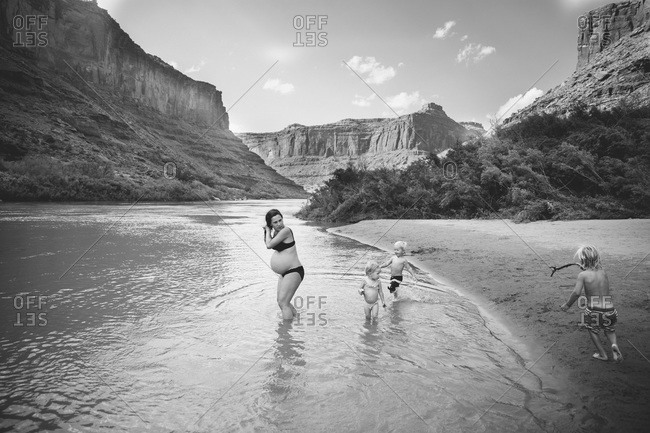 Family in the Colorado river, Utah, USA