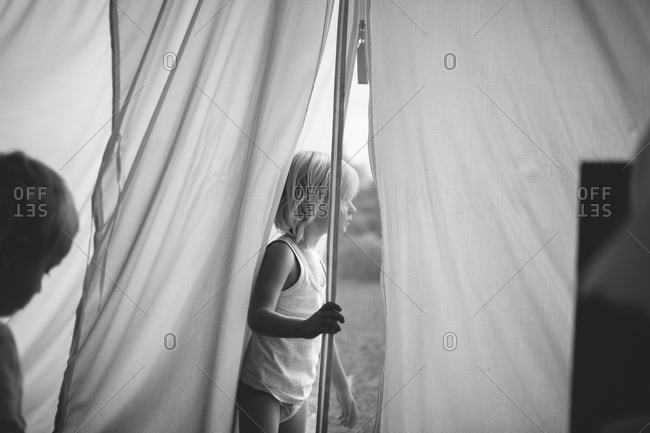 Boy standing in the entrance of a tent