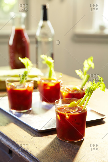 Shot of bloody marys on a tray with back light