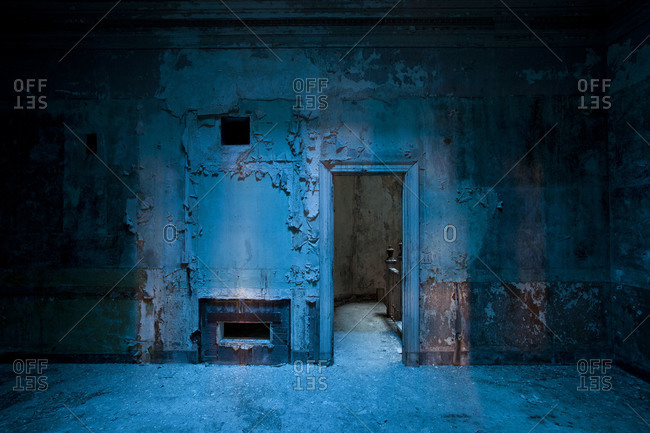 Interior of a decaying blue room