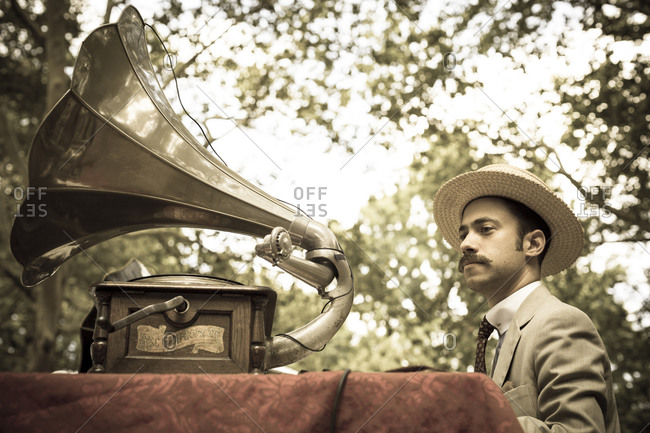 New York City, NY, USA - August 17, 2014: Man in boater hat with a gramophone at Jazz Age Lawn Party at Governors Island