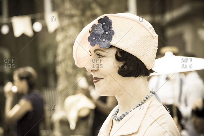 New York City, NY, USA - August 16, 2014: Profile of a woman wearing cloche hat at Jazz Age Lawn Party at Governors Island