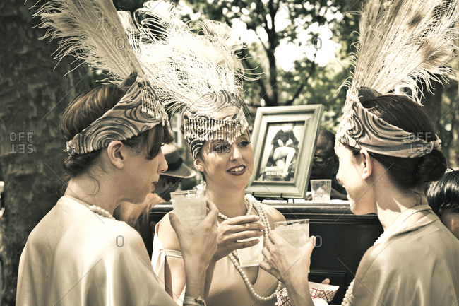 New York City, NY, USA - August 16, 2014: Three women drinking refreshments at Jazz Age Lawn Party at Governors Island