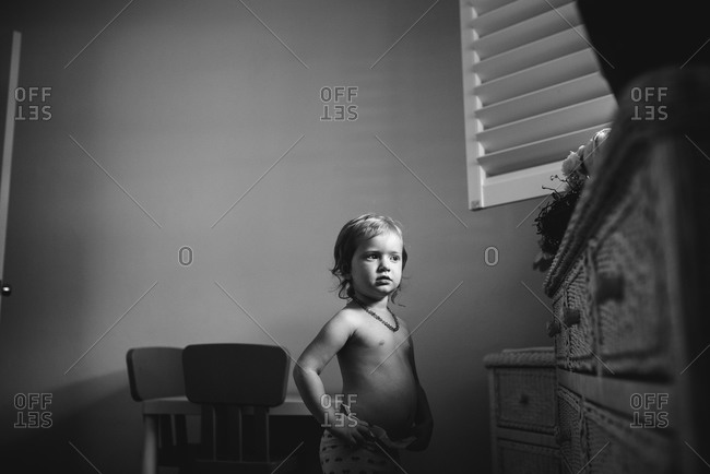 Young girl standing in a room