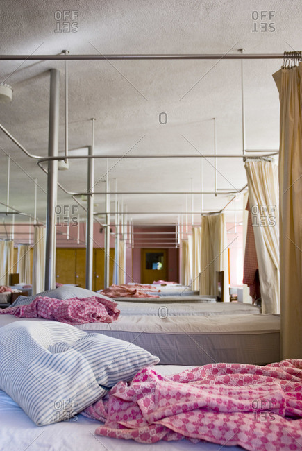 Empty beds in a dormitory