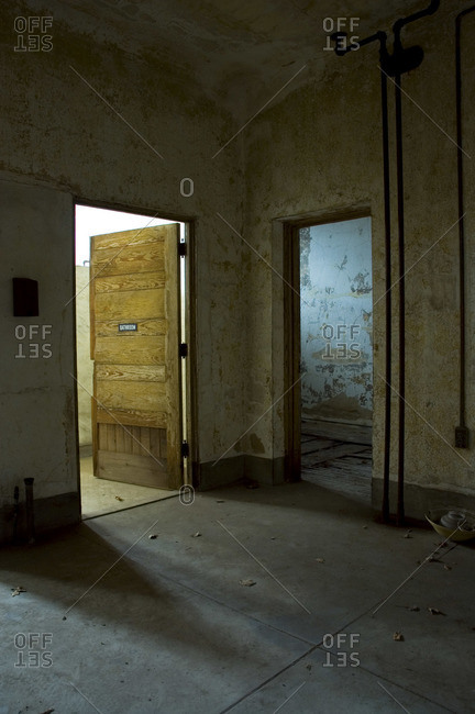 Entrance of a bathroom in an abandoned building