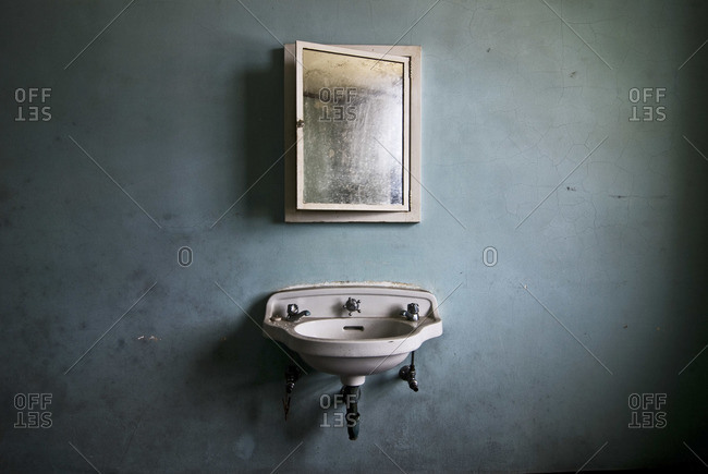 Abandoned room interior with a sink