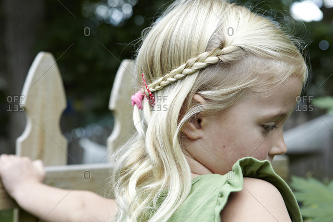 Close up of a blonde little girl with braided hair
