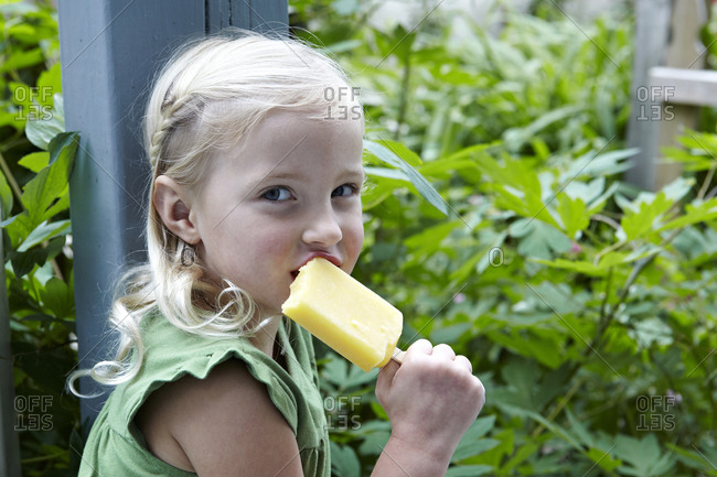 Little girl eating a Popsicle
