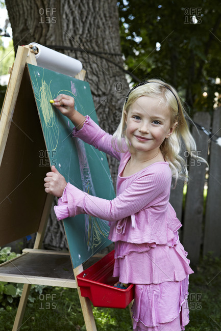 Girl drawing on a chalk board