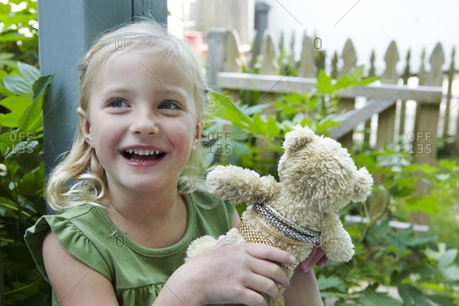 Portrait of girl with a teddy bear