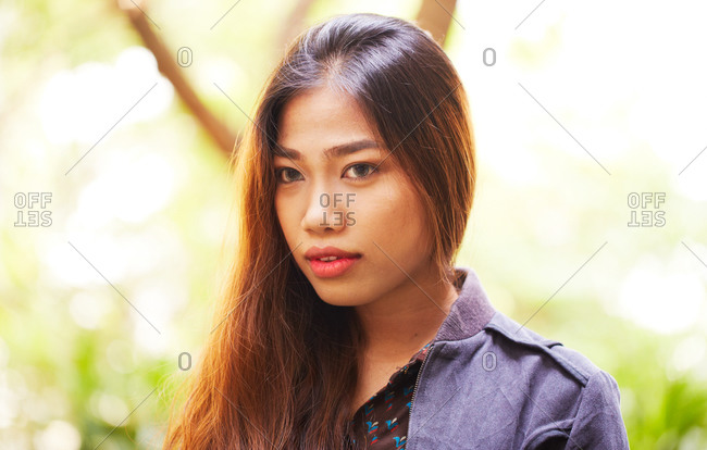 Young woman outside wearing colored contact lenses