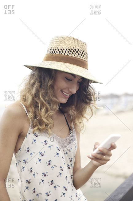 Woman texting at beach