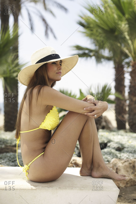 Woman in swimsuit and hat