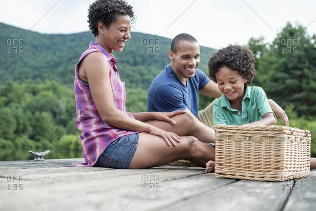 A family having a summer picnic at a lake