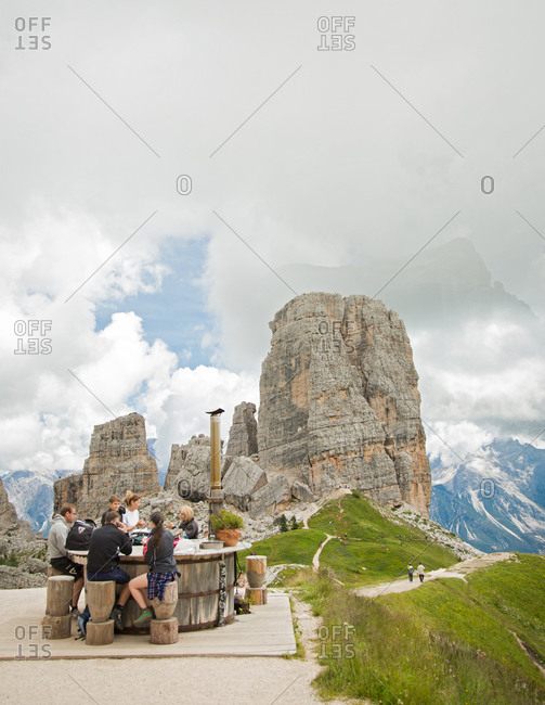 Cinque Torri, Italy - August 1, 2014: Picnic with the view of Cinque Torri, south-west of Cortina d'Ampezzo, Italy