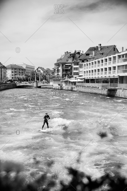 Thun, Switzerland - May 25, 2014: Man surfing in the river