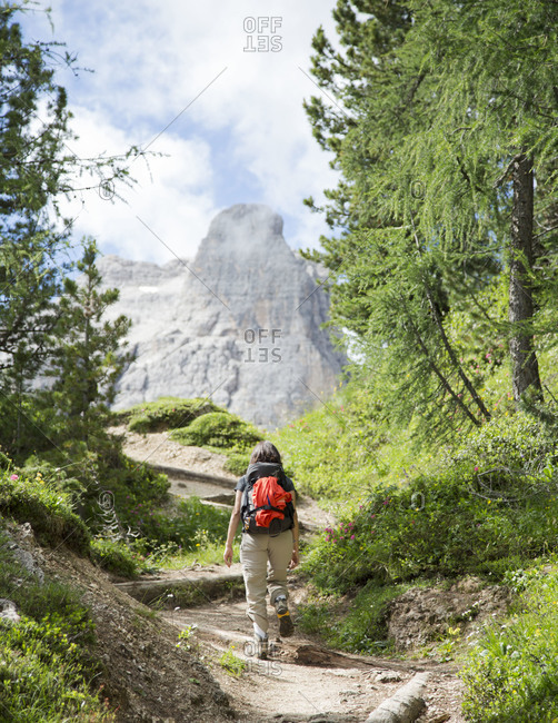 Trekker on the path to Cinque Torri, south-west of Cortina d'Ampezzo, Italy