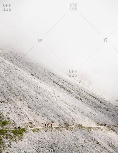 Trekkers on the trail to Tre Cime di Lavaredo loop near Cortina D'Ampezzo, Italy