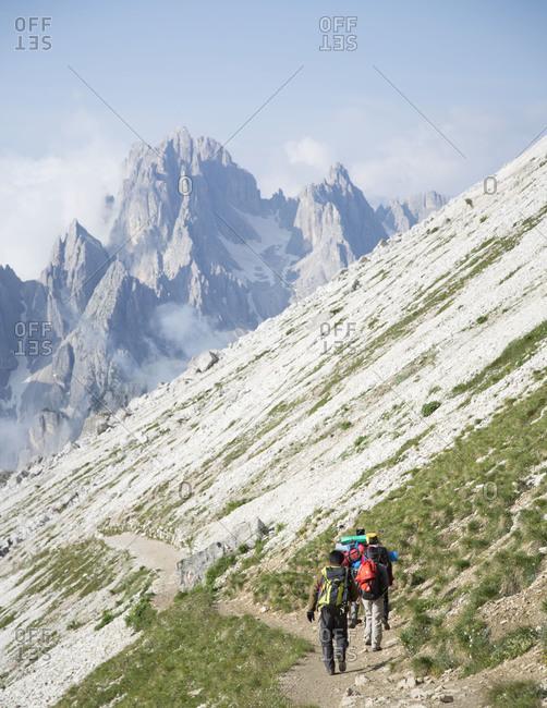 People trekking in the Tre Cime di Lavaredo loop, Italy