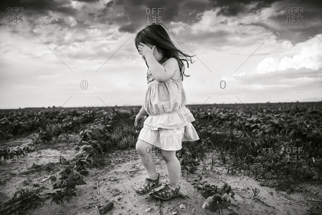 Side view of little girl standing on field