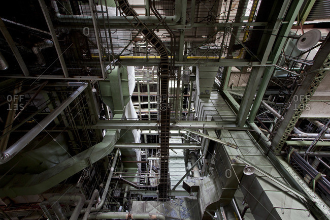 Low angle view of pipes in an abandoned power plant