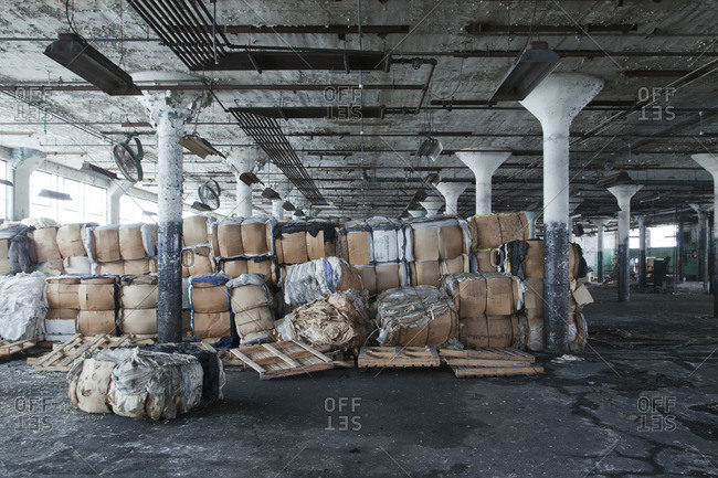 Boxes stacked in the hall of an abandoned tire plant
