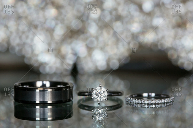 Wedding rings displayed on glass