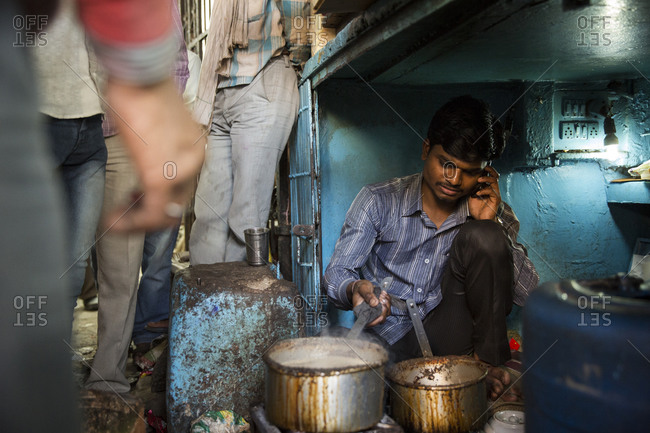 New Delhi, India - March 3, 2014: Man making chai on the street
