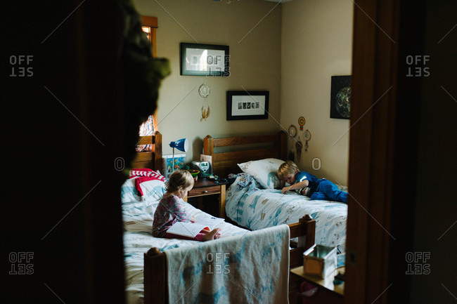 Siblings resting in their room