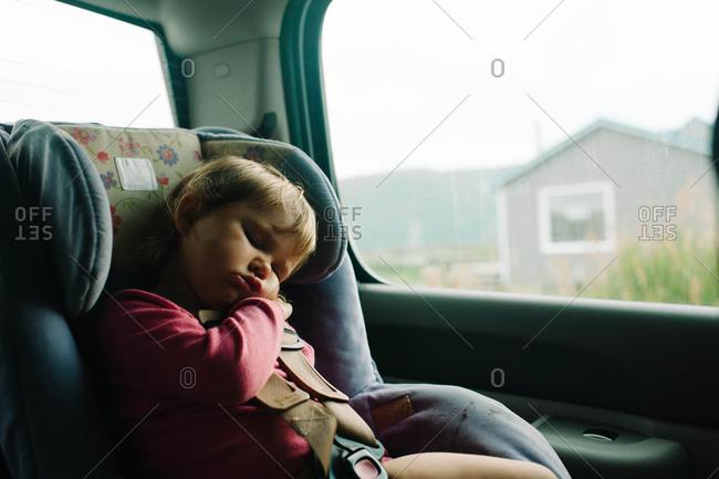 Little girl sleeping in car