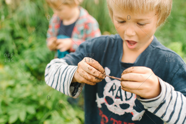 Boy playing with earthworm