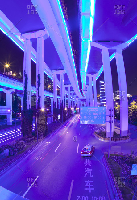 Elevated highway lit up at night in Shanghai, China