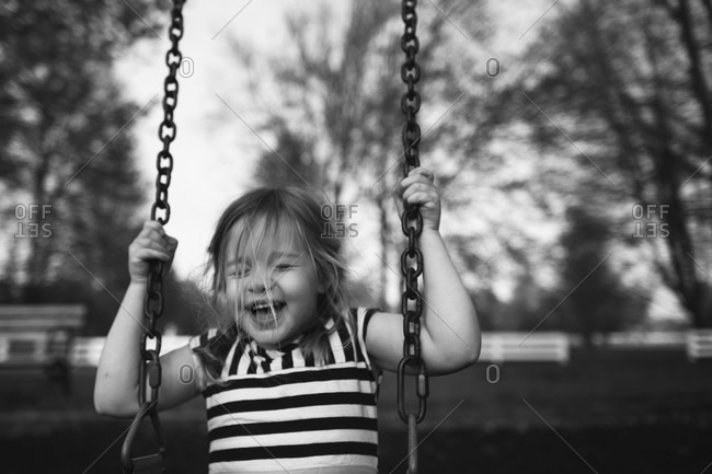 Young girl sitting on a swing