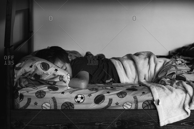 Young boy sleeping in a bed
