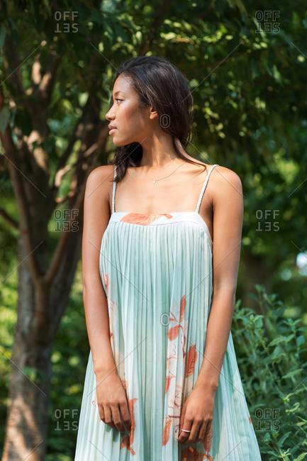 Woman standing in summer dress