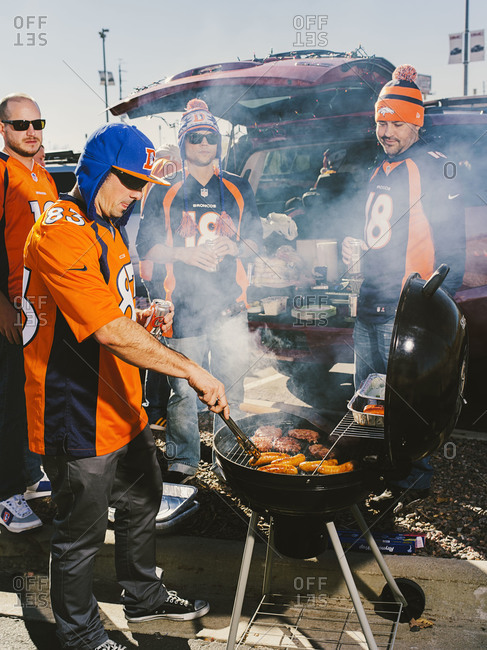 Denver, Colorado, USA - November 17, 2013: Tailgaters grill out before a Broncos vs Chiefs football game