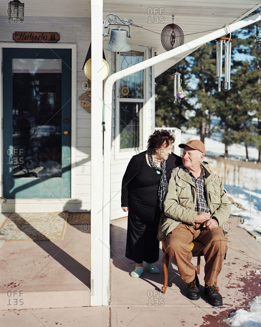 Kiowa, Colorado, USA - December 30, 2011: Ernie and Elaine Hartnagle sit outside of their ranch house