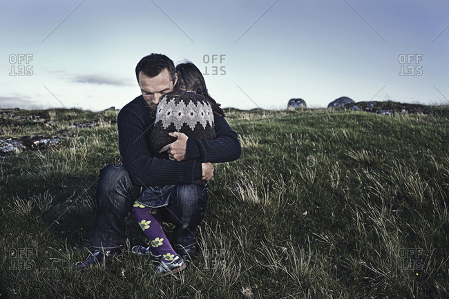 Faroe Islands - September 13, 2009: A father hugs his daughter after a walk
