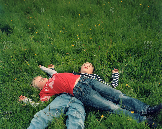 Faroe Islands - January 21, 2013: Noah and David rest after playing a game of soccer