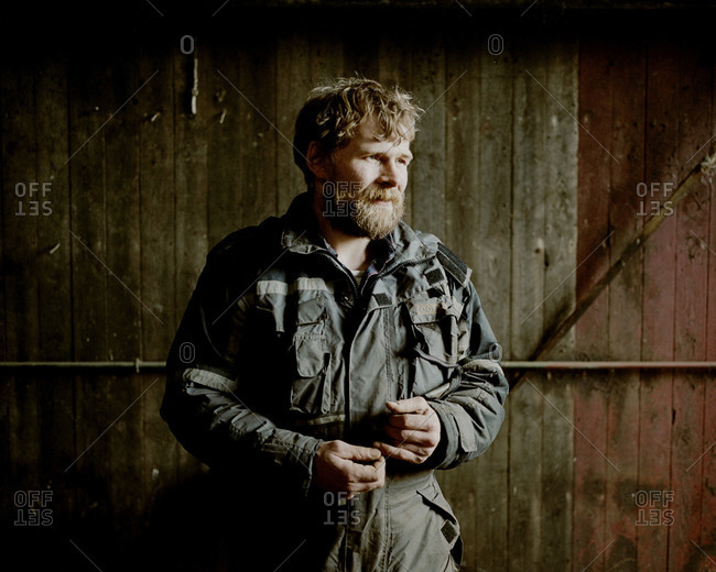 Faroe Islands - June 1, 2012: Sigert Patursson, one of the last Faroese farmers, stands in his barn outside of the town of Hoyv�k