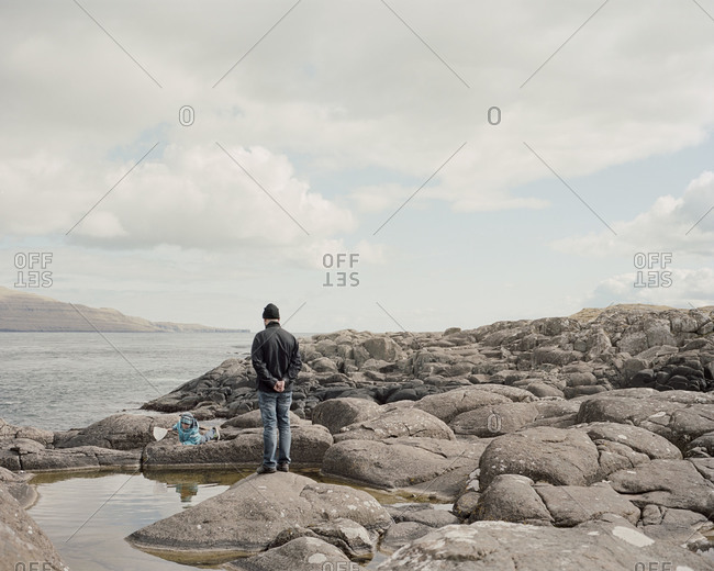 Faroe Islands - June 1, 2012:: A father and son fish in a tidal pool