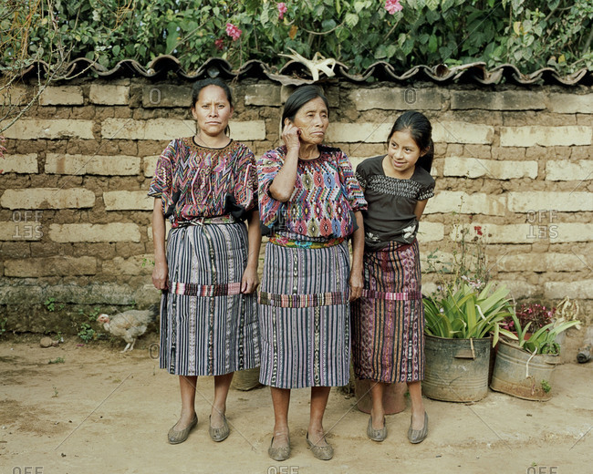 Lake Atitlan, Guatemala -  August 1, 2012: A Guatemalan woman sits outside of her home