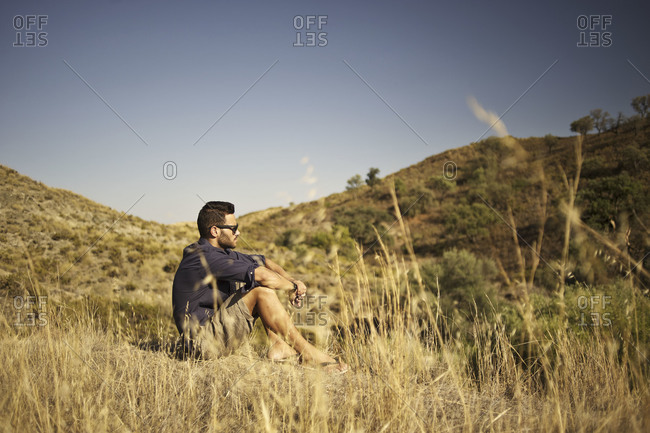 Man sitting in the hills