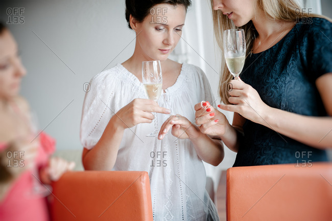 Drinking champagne at home before the wedding ceremony