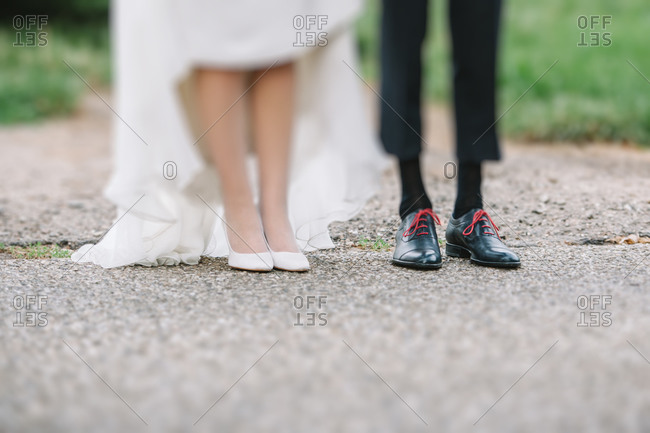 Close up of the feet of a newlywed couple