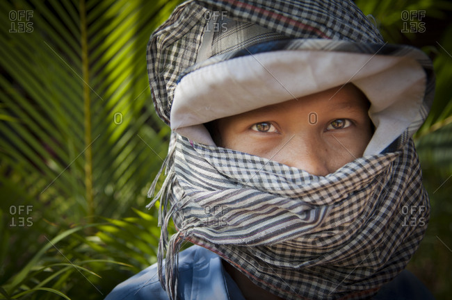 Cambodia, Southeast Asia - January 19, 2012: Portrait of worker wearing headscarf